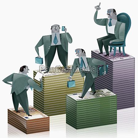 businessman standing on stacks of money