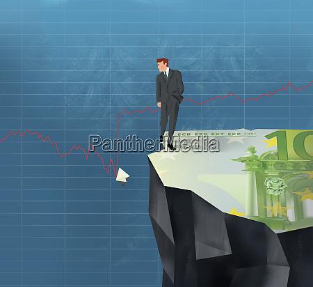 businessman on cliff looking at broken