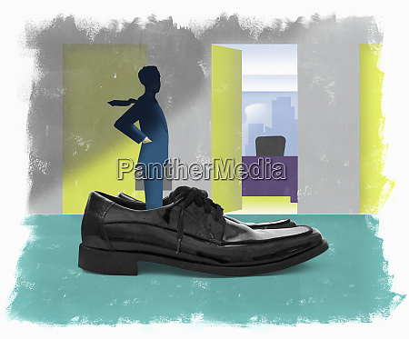 businessman standing in oversized shoes