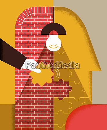 hand assembling jigsaw puzzle on brick