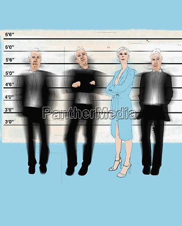businesswoman measuring up to businessmen