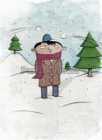 snowballs being thrown at anxious boy