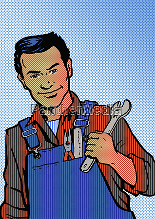 cheerful handyman wearing overalls and holding
