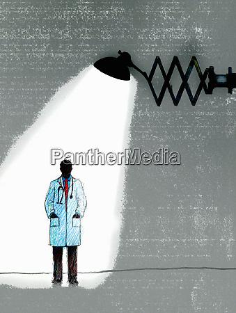 spotlight shining on doctor