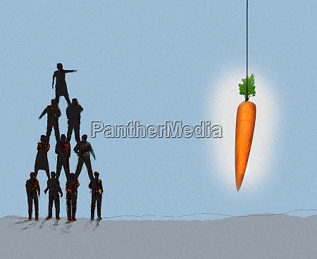 woman on top of human pyramid