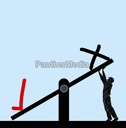 man struggling to raise cross on