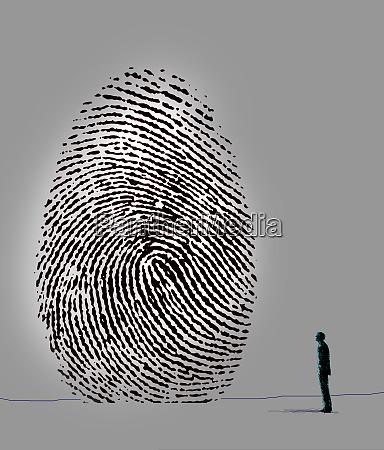 man looking up at large fingerprint