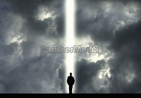 man standing in shaft of light