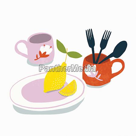 lemon with crockery and cutlery