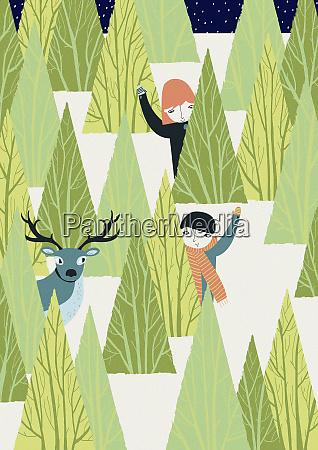 boy girl and deer behind trees