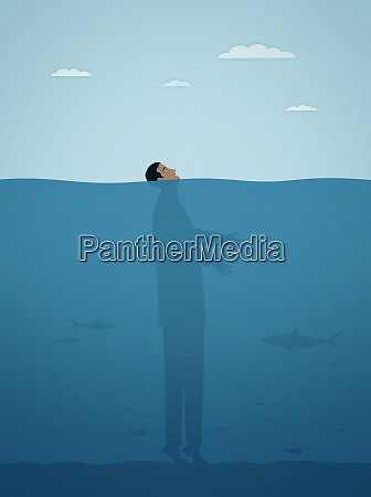 businessman on tiptoes on seabed with