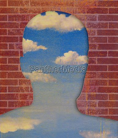 brick wall revealing blue sky in