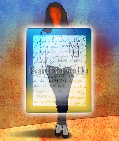 woman standing behind transparent digital tablet