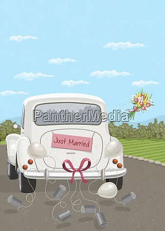 bouquet being thrown from car with