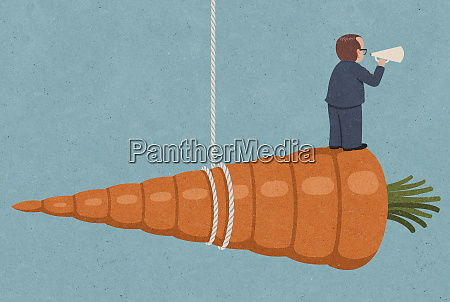 businessman with megaphone standing on top