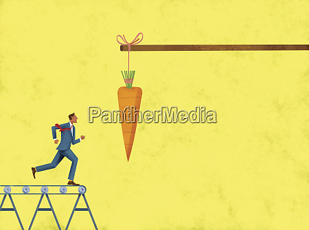 carrot dangling in front of businessman