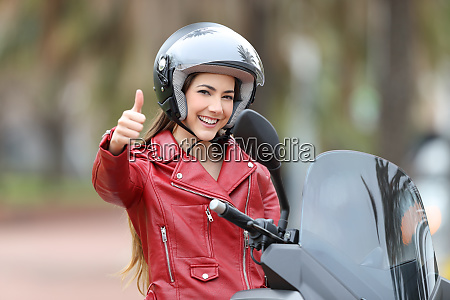 biker looking at you with thumb