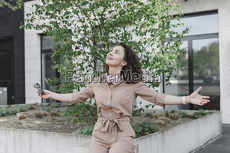contented businesswoman sitting with arms outstretched