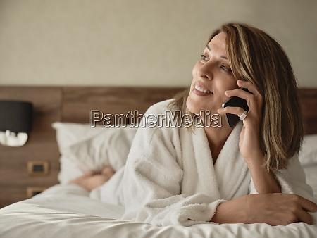 smiling senior woman talking on phone