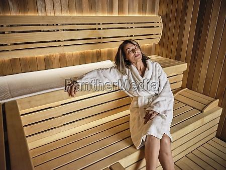 contemplating senior woman sitting on wooden